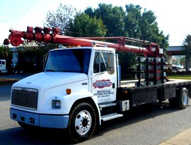 Why Should You Consider Buying Used Crane Trucks if You Run A Material Handling Business?